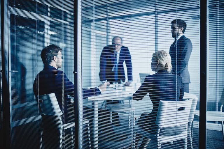 Several businesspeople interacting at office