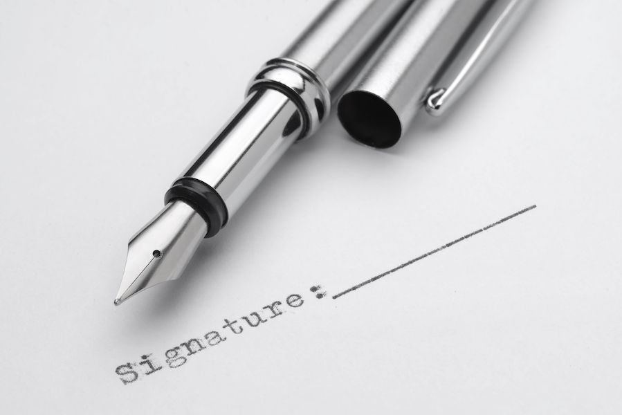 Stainless steel fountain pen with signature field printed by typewriter. Agreement or contract sign