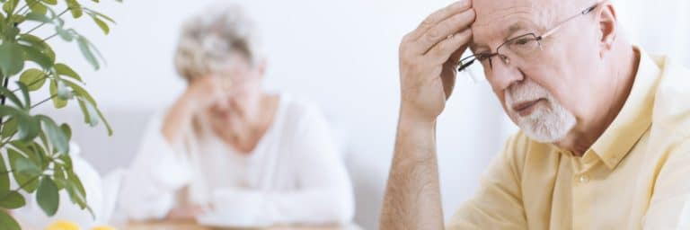 Worried elderly man and woman