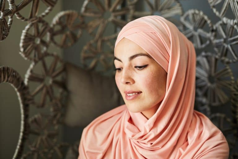 Contemplating young Muslim woman
