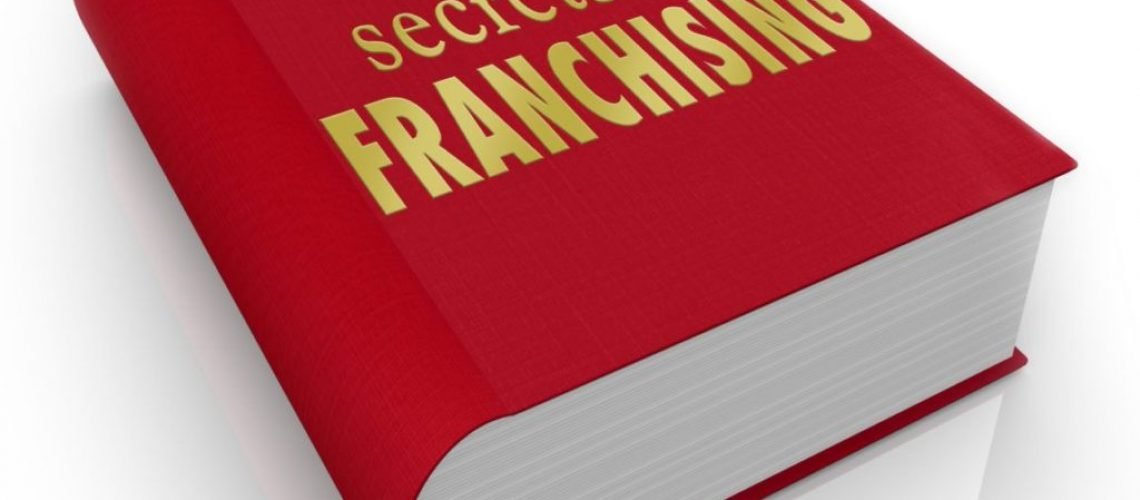 Secrets of Franchising title on a book to illustrate instructions, how-to information, advice and tips on successfully managing or running a licensed chain restaurant or other store or business